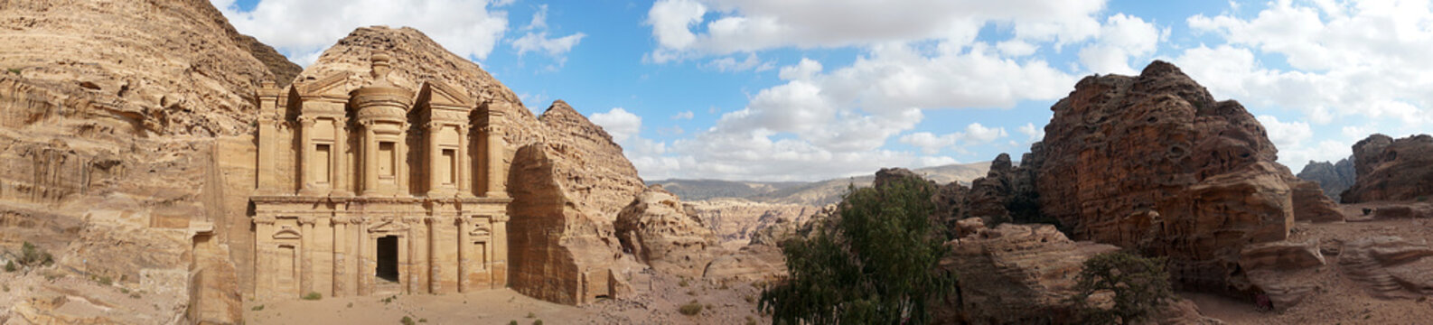 Ad-Deir-Nabataean rock temple of the I century ad, preserved near the city of Peter. a monumental building carved entirely from the rock. Lost city in the mountains. Panoramic view of Petra
