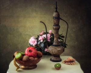 Still life with bouquet of azalea flowers and fruits