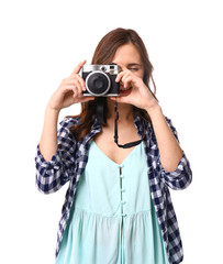 Female tourist with camera on white background