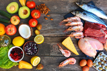 Healthy food of animal and vegetable origin on old wooden background. Concept of proper...