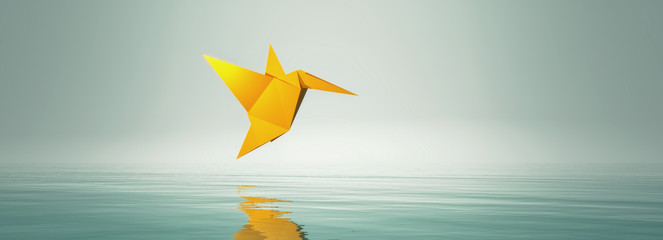 Conceptual image with origami fly bird.