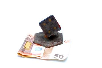 euro banknote pressed by vintage souvenir ,heavy rusty metal gambling dice