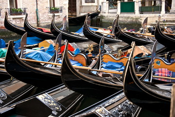 Gondolas parking on a canal, Venice, Italy