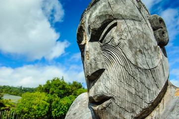 Traditional wood carved mask in the Te Puia Maori Cultural Center, Roturura, North Island, New Zealand