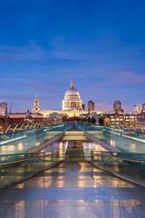 St Pauls Cathedral at night, seen across Millennium Bridge, City of London, London, England, United Kingdom