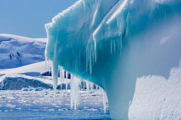 Icicles hang from a glacial iceberg at Cierva Cove, Antarctica, Polar Regions