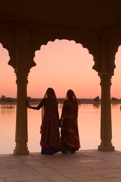 Silhouettes of women in traditional dress, Jaisalmer, India
