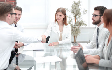 young business woman shaking hands with investor