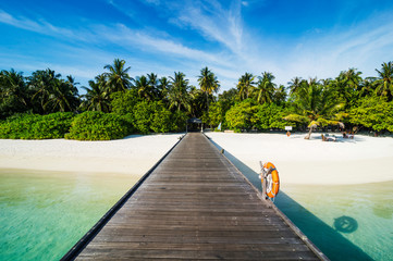 Long pier leading to a small island over turquoise water, Sun Island Resort, Nalaguraidhoo island, Ari atoll, Maldives