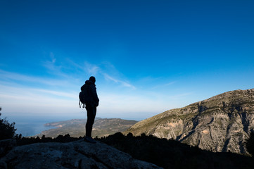 A woman hiking in the Taygetos mountains on the Mani peninsula in the Peloponnese in Greece