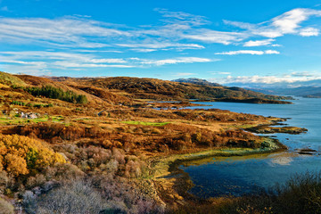 Sweeping autumn view of the tree covered hills and valley along the banks of Loch Sunart in the Ardnamurchan Peninsula