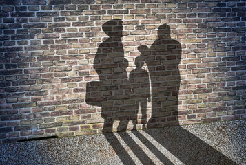 Shadow on the wall of a refugee family