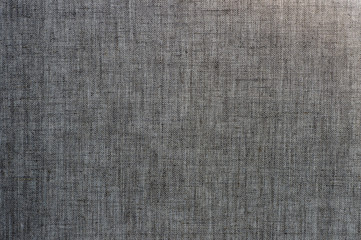 Canvas of linen grey fabric, with a rough gradient of illumination. Textured background