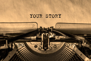 your story is printed on a sheet of paper on a vintage typewriter. writer, journalist.