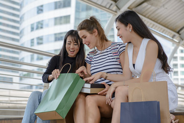 Women are discussing about shopping