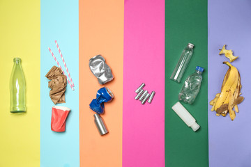 Different garbage on color background Wall mural