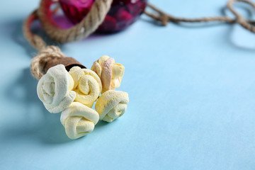 Creative bouquet made of tasty marshmallow on color background