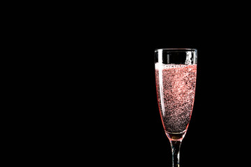 Glass of champagne on dark background