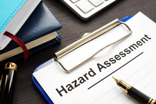Hazard assessment form with clipboard on a desk.