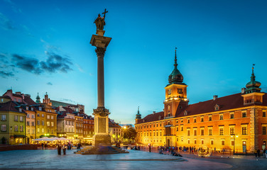 Royal Castle, ancient townhouses and Sigismund's Column in Old town in Warsaw, Poland. Night view,...