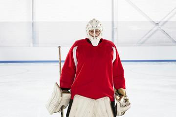 Portrait of ice hockey goalkeeper in red uniform