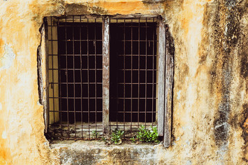 old vintage window of house old fashion design classic on yellow rustic painted concrete wall background