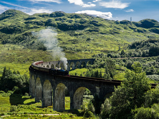 Steam Train passing a viaduct between Fort William and Mallaig