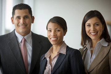 Portrait of three smiling business colleagues.