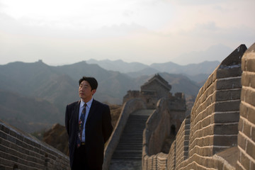 Portrait of Chinese businessman at the Great Wall Of China.