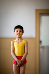 Portrait of a boy standing in a gym.