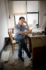 Teenage boy looking bored in an art room.