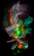 The abstract image painted by moving light and moving objects. Improvisational movements by light. Light in motion. Color abstraction.