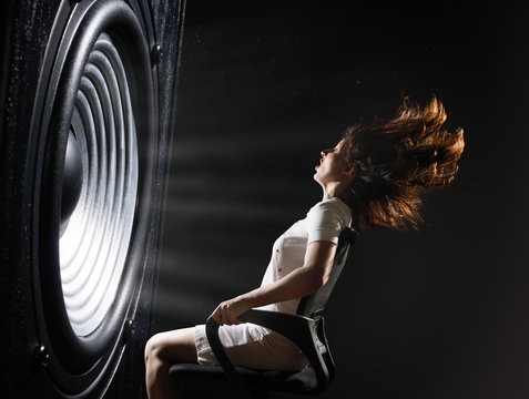 The sound wave set back an office chair with young woman.