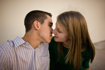 Teenage couple about to kiss