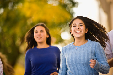 Girls running down footpath