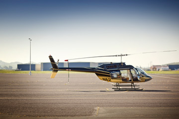 Helicopter sitting on the tarmac.