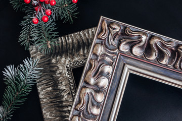 Two wooden picture frames on black background. Christmas decor. Framing workshop concept.