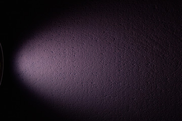 Purple ray of light against textural background