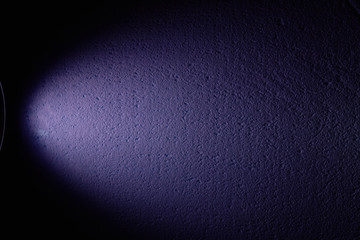 Wide ray of violet color on a black background