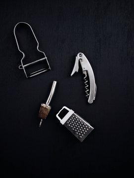 Kitchen utensils on black background