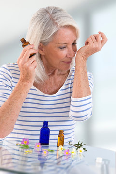 Herbal Medicine , womanold woman smelling essential oil