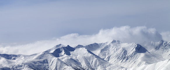 Fototapete - Panoramic view on snowy winter mountains in haze