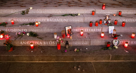 Candles, flowers and photographs of victims are pictured on the a memorial at the site of the Christmas market's truck attack at Breitscheidplatz square in Berlin
