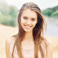 Beautiful smiling girl face - close up