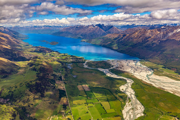 New Zealand. South Island, Otago region. The nothern end of Lake Wakatipu and Glenorchy settlement surrounded by mountains