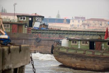 Ships docking along a wharf.
