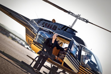 Businesswoman disembarking helicopter