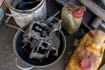 Dirty Diesel Engine in Aluminum Pan with Oil Bottles - Recycling - Vintage Garage
