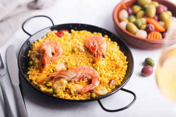 Traditional Spanish paella with seafood. Prepared in traditional pan