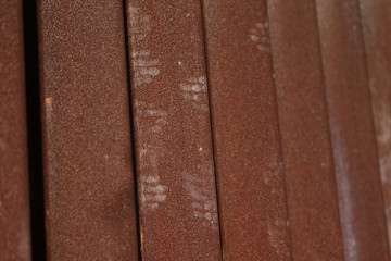 Hand prints from dirt and mud are seen on the border fence in Tijuana, Mexico